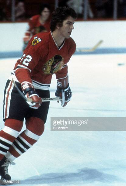 Grant Mulvey of the Chicago Blackhawks skates on the ice during warmups before an NHL game against the Montreal Canadiens circa 1975 at the Montreal...