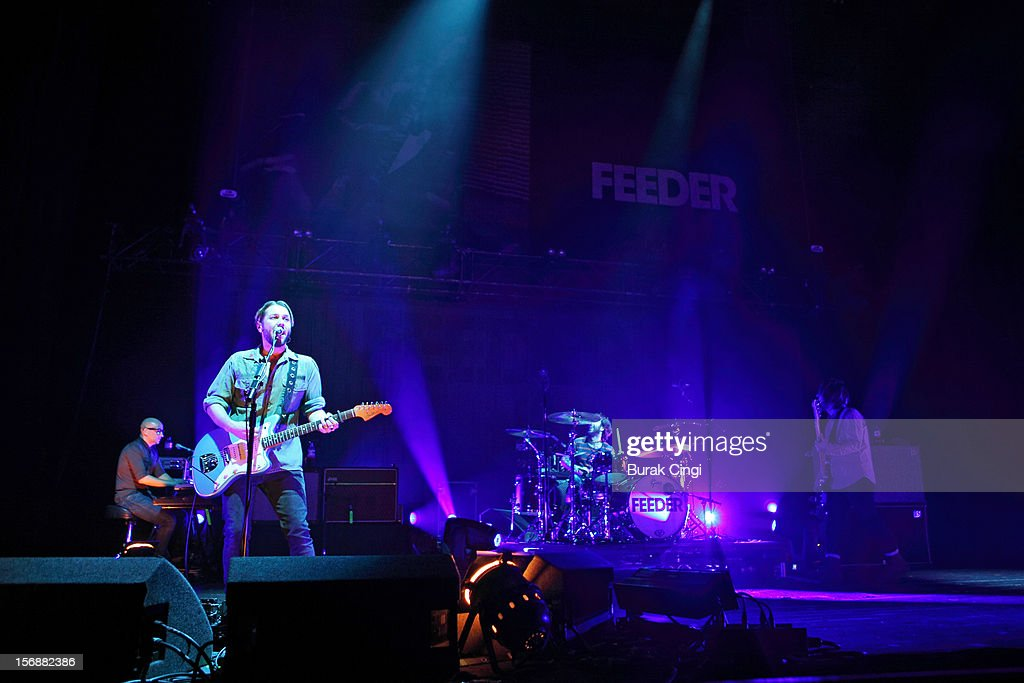 <a gi-track='captionPersonalityLinkClicked' href=/galleries/search?phrase=Grant+Nicholas&family=editorial&specificpeople=228982 ng-click='$event.stopPropagation()'>Grant Nicholas</a>, Karl Brazil and Taka Hirose of Feeder perform at Brixton Academy on November 23, 2012 in London, England.