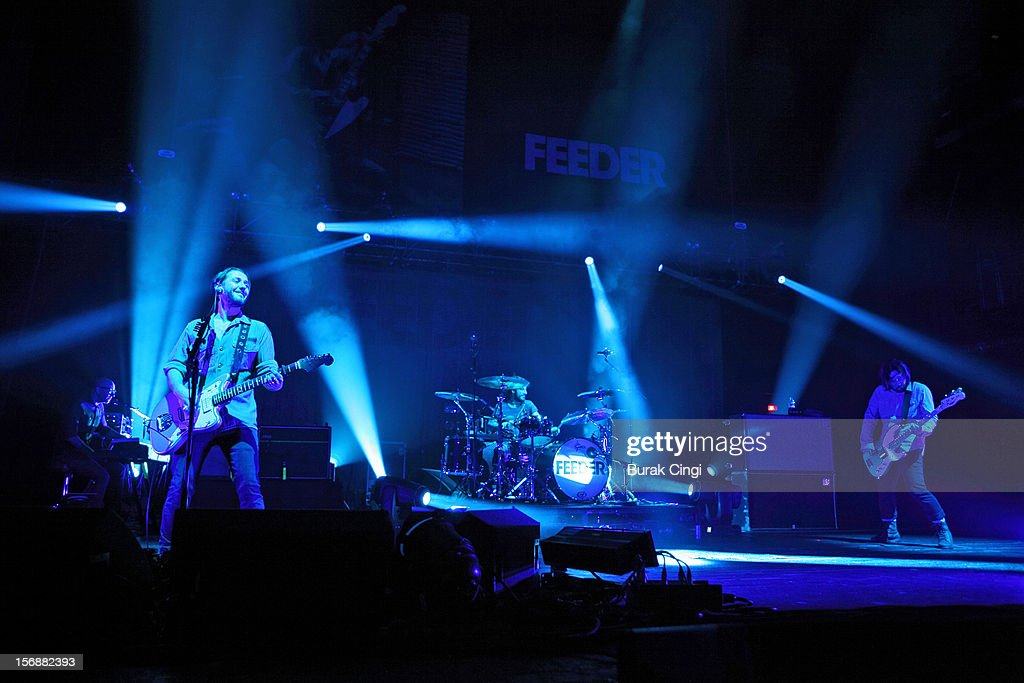 Grant Nicholas, Karl Brazil and Taka Hirose of Feeder perform at Brixton Academy on November 23, 2012 in London, England.