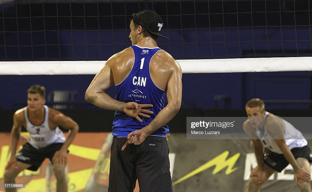 Grant O'Gorman of Canada signals to his partner during FIVB Under 21 World Championships on June 22, 2013 in Umag, Croatia.