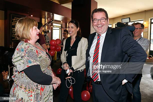 Grant Robertson and fellow MP Jacinda Ardern speak to a supporter at Astoria Cafe on September 15 2013 in Wellington New Zealand The Labour party...