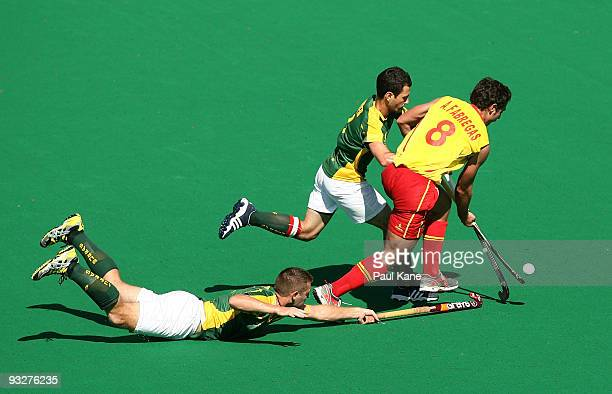 Grant Schubert and Jamie Dwyer of Australia challenge Alex Fabregas of Spain during the first test match between the Australian Kookaburras and Spain...