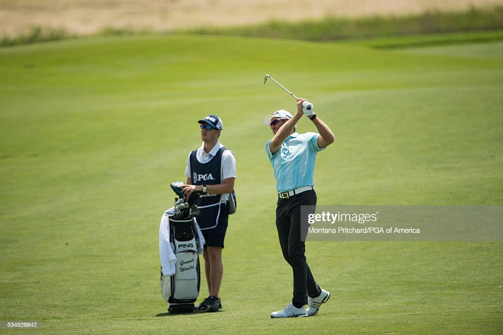 <a gi-track='captionPersonalityLinkClicked' href=/galleries/search?phrase=Grant+Waite&family=editorial&specificpeople=869157 ng-click='$event.stopPropagation()'>Grant Waite</a> of New Zealand hits his shot on the sixth hole during the first round for the 77th Senior PGA Championship presented by KitchenAid held at Harbor Shores Golf Club on May 26, 2016 in Benton Harbor, Michigan.