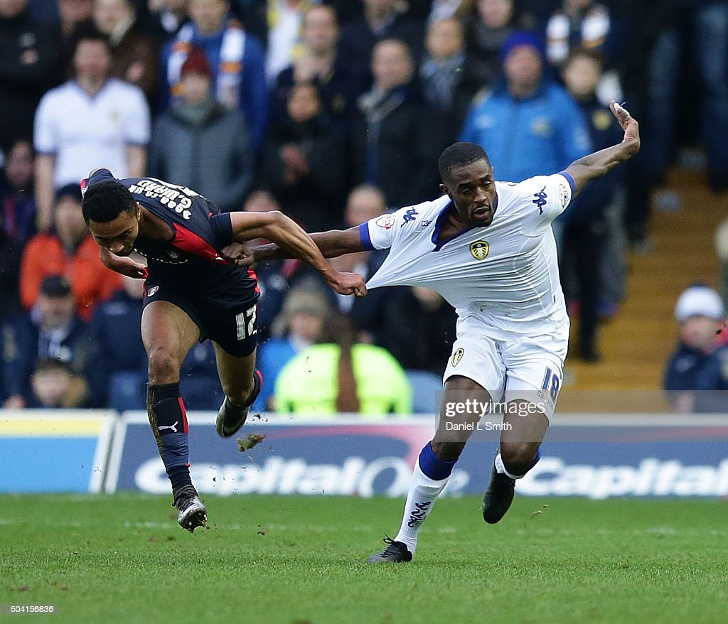 Grant Ward of Rotherham United FC pulls on Mustafa Carayol of Leeds United FC during The Emirates FA Cup Third Round match between Leeds United and Rotherham United at Elland Road on January 9, 2016 in Leeds, England.