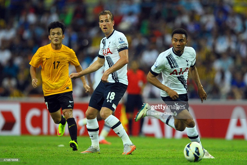 Grant Ward of Tottenham Hotspur runs with the ball while Harry Kane looks on during the pre-season friendly match between Malaysia XI and Tottenham Hotspur at Shah Alam Stadium on May 27, 2015 in Shah Alam, Malaysia.