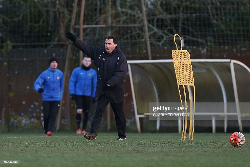 US Granville football club's headcoach Johan Gallon leads the training session near the Louis Dior stadium on February 8, 2016 in Granville, northwestern France. / AFP / CHARLY TRIBALLEAU