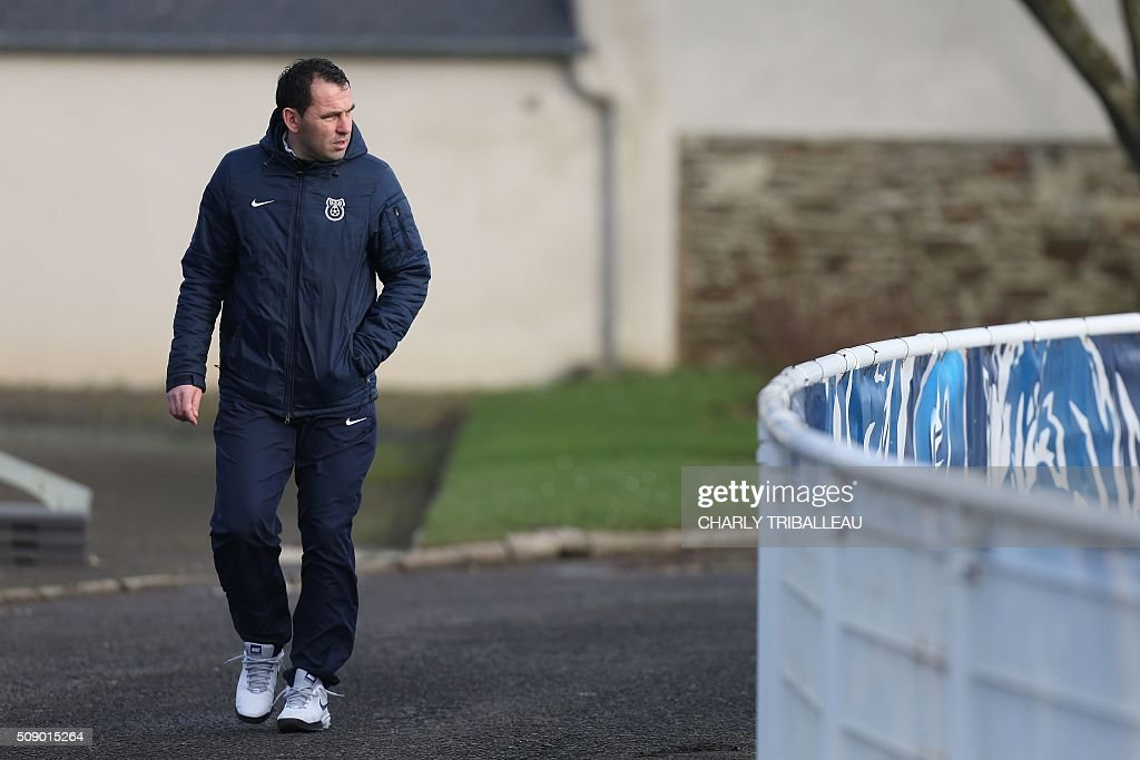US Granville football club's headcoach Johan Gallon walk at the Louis Dior stadium on February 8, 2016 in Granville, northwestern France. / AFP / CHARLY TRIBALLEAU