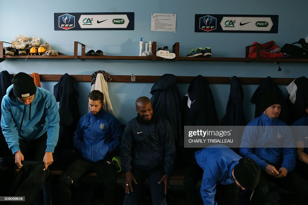 US Granville football club's players are pictured in the locker-room before the training session near the Louis Dior stadium on February 8, 2016 in Granville, northwestern France. / AFP / CHARLY TRIBALLEAU
