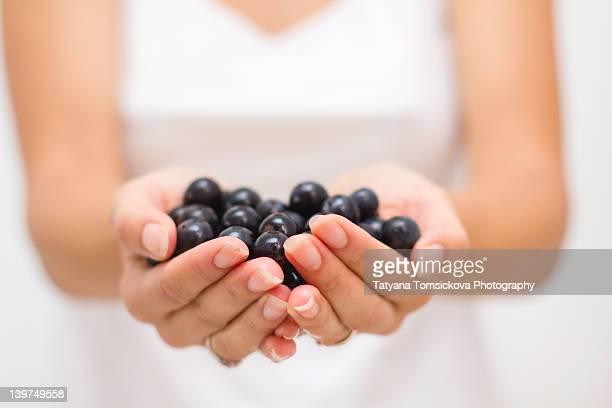 Grape in woman hands