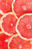 Juicy grapefruit slices as a colorful background