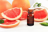 with fresh pink citrus fruit pulp in pieces. Sweet natural aromatherapy spa and health care.