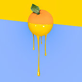 Grapefruit with dripping yellow paint on pastel blue and  yellow background. Minimal food concept.