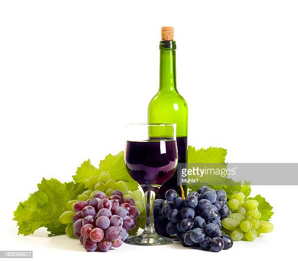 Grapes, a glass of wine and a bottle of wine composition