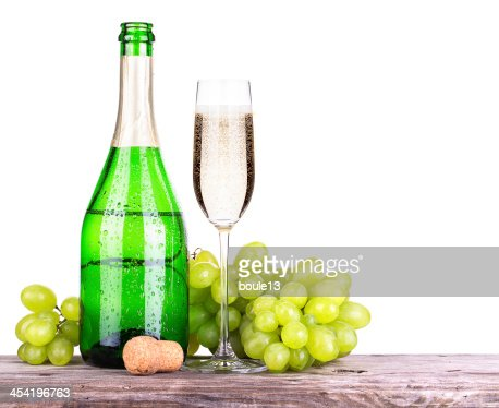 grapes  with bottle of champagne and glass : Stock Photo