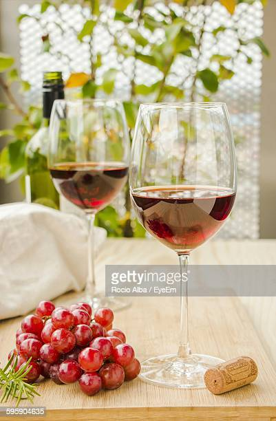 Grapes With Red Wine Served On Table
