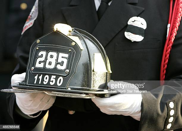 Grapevine fire captain Jamey Shipler holds the presenter's helmet of New York firefighter Raymond York during a remembrance ceremony at the 911...
