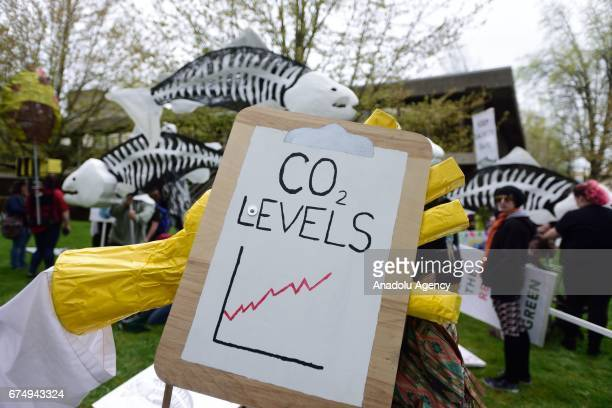 A graph depicts rising CO2 levels during the People's Climate March in Portland Ore United States on April 29 2017 Thousands turned out in solidarity...