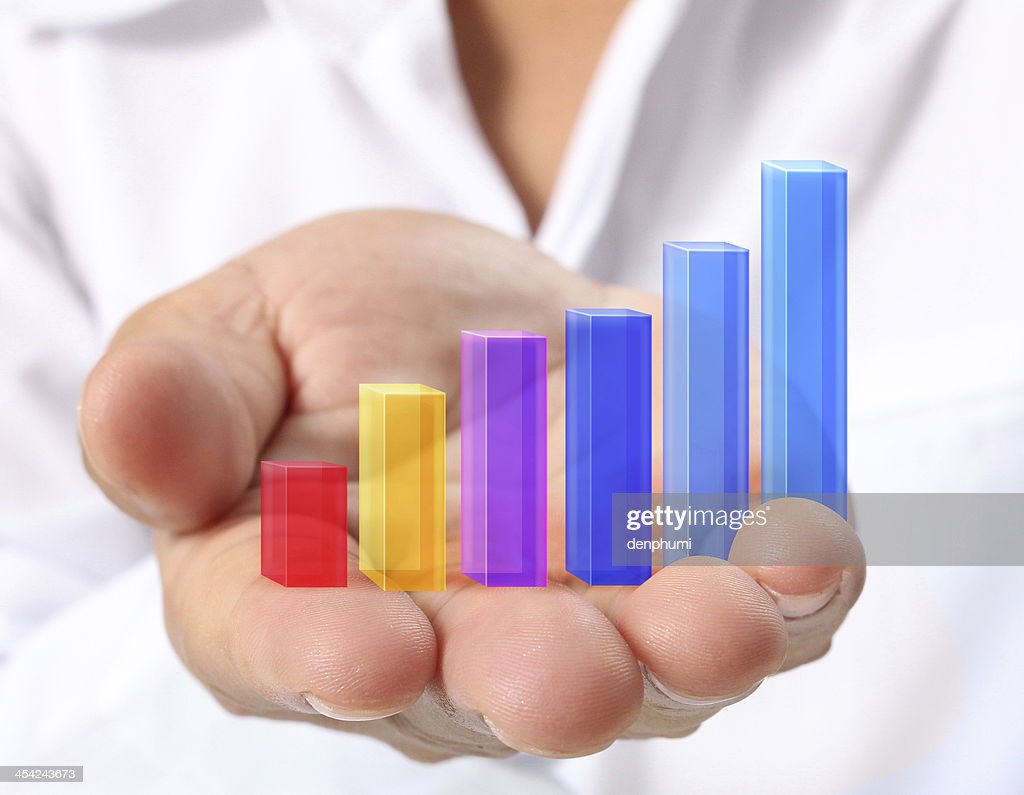 Graph in hand : Stock Photo