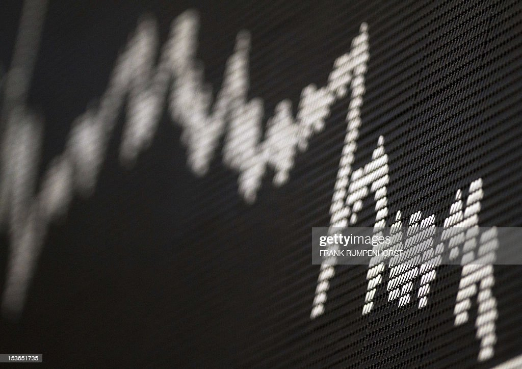 A graph showing the German DAX index is pictured in Frankfurt am Main on November 1, 2011 at the German Stock Exchange. German stock prices nosedived by more than 6.0 percent in afternoon trade amid turmoil triggered by the shock announcement of a Greek referendum on last week's EU debt rescue package. AFP PHOTO / FRANK RUMPENHORST GERMANY OUT