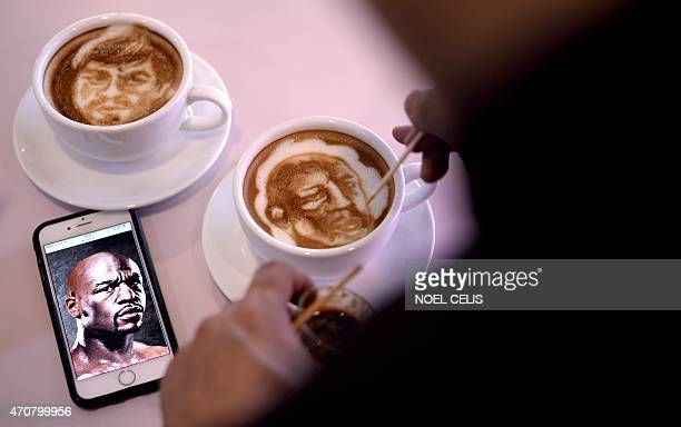 Graphic artist and barista Zach Yonzon uses coffee latte milk froth to illustrate depictions of Philippine boxing icon Manny Pacquiao and US American...