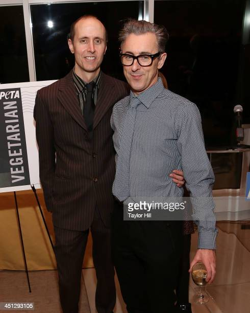 Graphic artist Grant Shaffer and husband Alan Cumming attend the unveiling of the PETA Vegetarian Icon Postage sheet on November 21 2013 in New York...