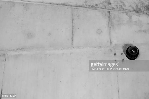 graphic concrete background with surveillance camera