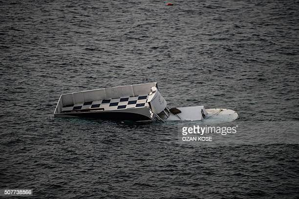 Graphic content / A boat that capsized is seen on January 31 2016 in Canakkale's Bademli district after at least 37 migrants drowned when their boat...