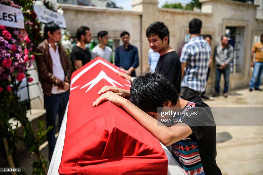 A child leans on the coffin of his uncle, suicide attack victim Hamidullah Safar on June 30, 2016 in Istanbul during his funeral two days after a suicide bombing and gun attack targeted Istanbul's airport, killing at least 36 people. The death toll from the triple suicide bombing and gun attack that occurred on June 28, 2016 at Istanbul's Ataturk airport has risen to 43 including 19 foreigners. The government has pointed the finger of blame at the Islamic State group and Turkish police rounded up 13 suspected IS jihadists in raids at 16 different locations across Istanbul on June 30. KOSE
