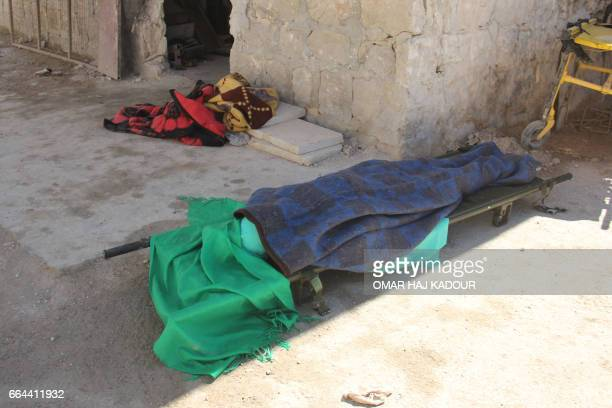 Graphic content / A covered body lies outside a hospital in Khan Sheikhun a rebelheld town in the northwestern Syrian Idlib province following a...