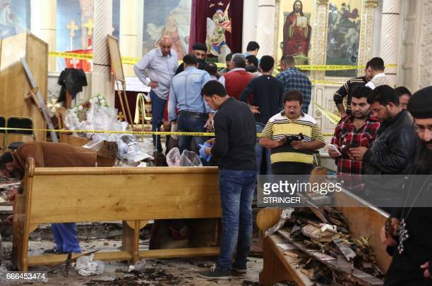 Graphic content / A general view shows forensics collecting evidence at the site of a bomb blast which struck worshippers gathering to celebrate Palm...