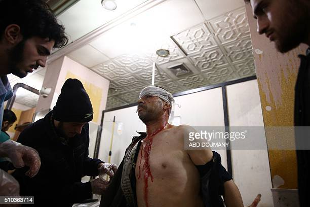 Graphic content / A man receives treatment at a makeshift hospital following a reported airstrike on the besieged rebelcontrolled city of Douma a...