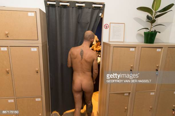 Graphic content / A man walks into the newly opened nudist restaurant 'o'naturel' in Paris on December 5 2017 Leave your coats your pants and your...