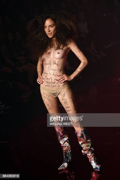 Graphic content / A model displays a creation from the Australian label Romance Was Born during Fashion Week Australia in Sydney on May 18 2017 / AFP...