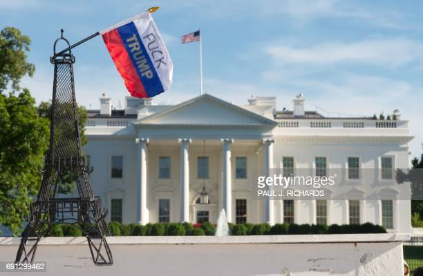 Graphic content / A model Eiffel tower is placed on a wall during a demonstration in front of the White House in Washington DC on June 1 objecting to...