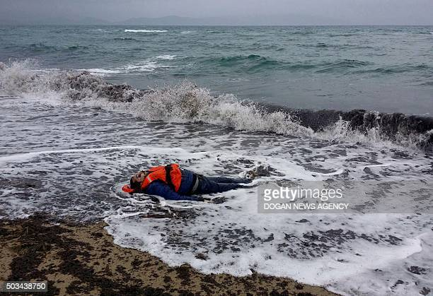 Graphic content / A photo shows the body of a migrant man washed up ashore in Izmir's Dikili district on January 5 2016 The bodies of seven migrants...