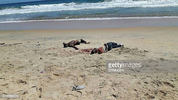 Graphic content / A photo taken by a witness at the scene shows bodies on the beach after heavily armed gunmen opened fire on March 13 2016 at a...