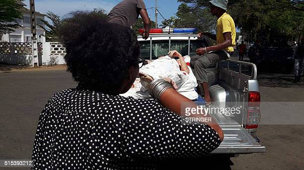 Graphic content / A photo taken by a witness at the scene shows the victims of a fusillade being loaded on a pickup truck in front of a hotel in...