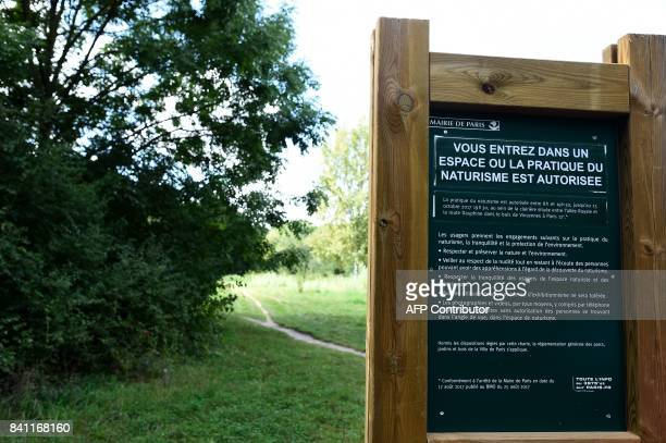 Graphic content / A photo taken on August 31 2017 shows a sign reading 'you are entering a space where the practise of naturism is authorised' at a...