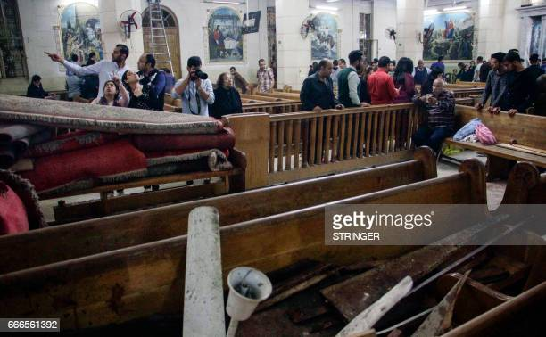 Graphic content / A picture taken on April 9 2017 shows a general view of the destruction debris and blood stains on the benches of the Mar Girgis...