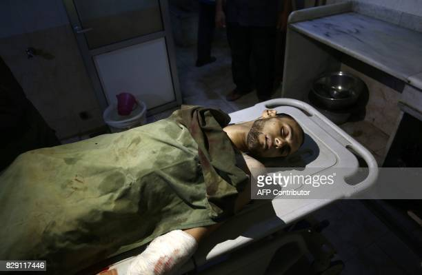 Graphic content / A picture taken on August 10 2017 shows the body of a Syrian man who was reportedly killed during regime shellings in the...