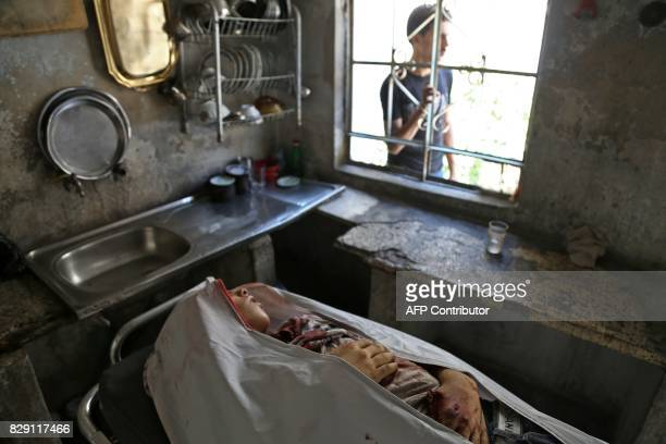 Graphic content / A picture taken on August 10 2017 shows the body of a Syrian child who was reportedly killed during regime shellings in the...