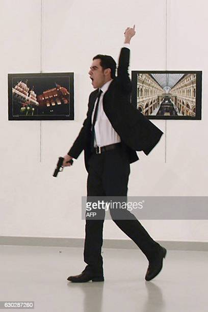 Graphic content / A picture taken on December 19 2016 shows Mevlut Mert Altintas the gunman who killed Russia's Ambassador to Turkey during an attack...