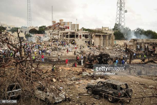 Graphic content / A picture taken on October 15 2017 shows a general view of the scene of the explosion of a truck bomb in the centre of Mogadishu A...