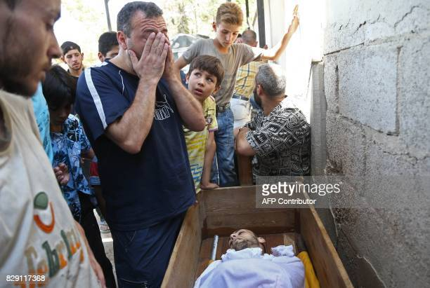 Graphic content / A Syrian man weeps over the body of his brother who was reportedly killed during regime shellings in the rebelcontrolled town of...