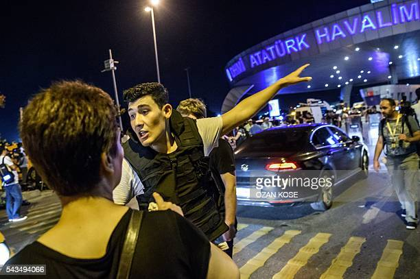 Graphic content / A Turkish police officer directs a passenger at Ataturk airport in Istanbul June 28 2016 after two explosions followed by gunfire...