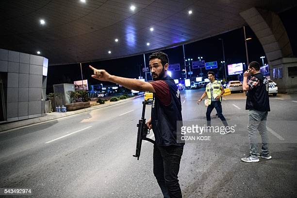 Graphic content / A Turkish police officer reacts at Ataturk airport`s main gate on June 28 2016 in Istanbul after two explosions followed by gunfire...