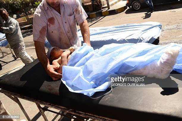 Graphic content / A wounded Syrian child is rushed into a hospital after she was hit by mortar shells that targeted Aleppo's government controlled...