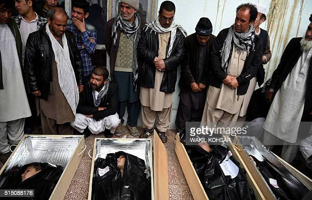 Graphic content / Afghan mourners surround the coffins of members of a family who drowned trying to cross the Aegean Sea between Turkey and Greece...