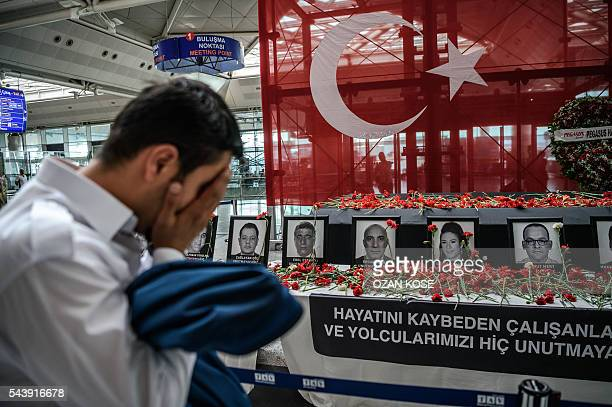 Graphic content / An airport employee mourns for his collegues as he looks at the pictures of killed airport employees at Ataturk airport...