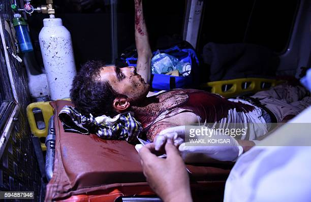 Graphic content / An injured Afghan man lay on a stretcher in an ambulance near the site of an explosion that targeted the elite American University...